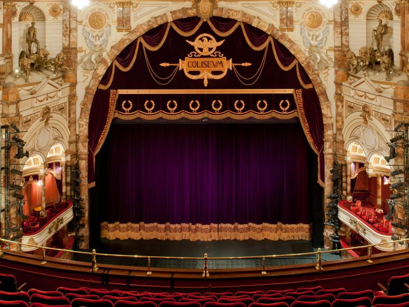 View of the London Coliseum stage with curtain down from the upper circle