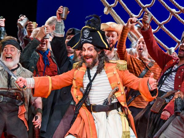 ENO's The Pirates of Penzance - Joshua Bloom as the Pirate King and Company. Photo by Tristram Kenton