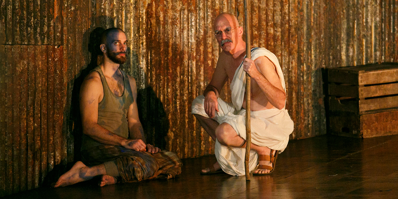 ENO's Satyagraha - Alan Oke as Gandhi and member of Skills Ensemble. Photo by Donald Cooper