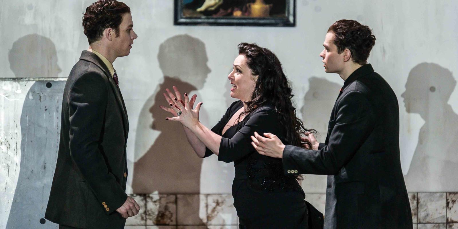 An image of Christopher Ainslie, Rebecca Evans and Matt Casey in Richard Jones's 2014 production of Rodelinda