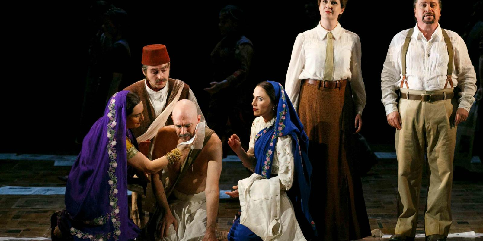 An image of Janis Kelly, Nicholas Masters, Alan Oke, Stephanie Marshall, Clare Eggington and Nicholas Folwell in Phelim McDermott's 2013 production of Satyagraha