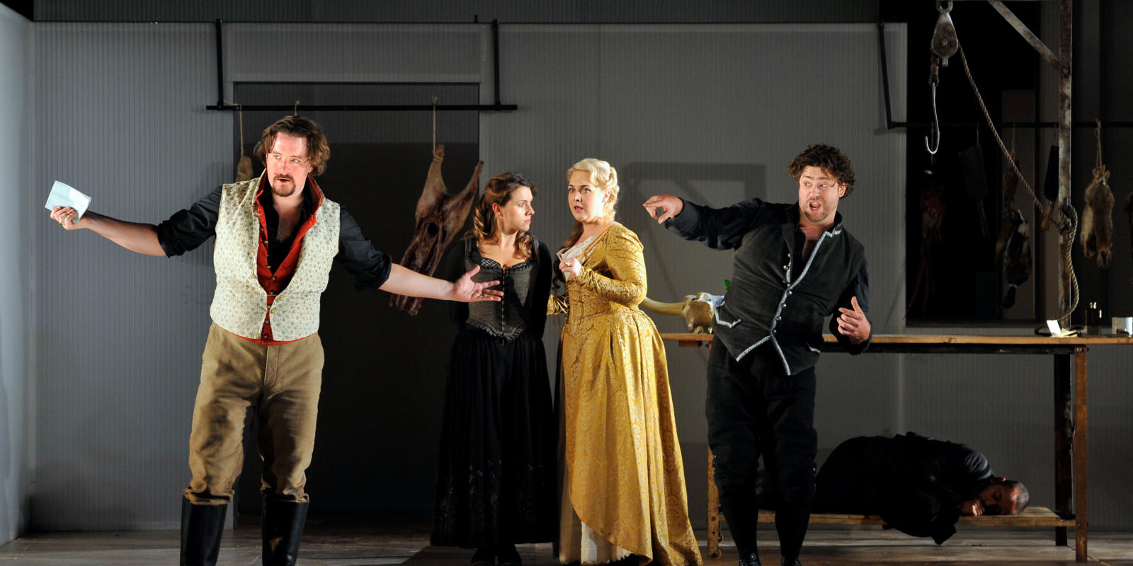 An image of Benedict Nelson, Mary Bevan, Sarah Jane Brandon and David Stout in Fiona Shaw's 2014 production of The Marriage of Figaro