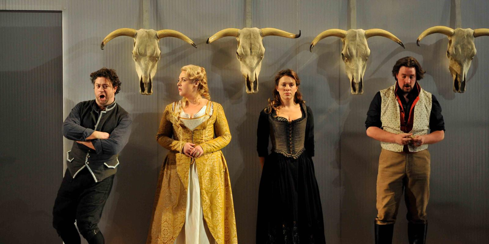 An image of David Stout, Sarah Jane Brandon, Mary Bevan and Benedict Nelson in Fiona Shaw's 2014 production of The Marriage of Figaro