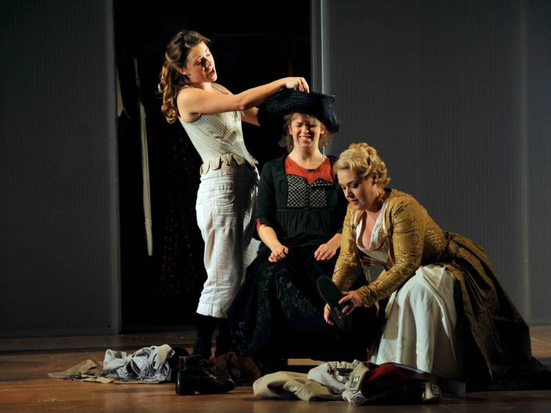 An image of Mary Bevan, Samantha Price, Sarah Jane Brandon in Fiona Shaw's 2014 production of The Marriage of Figaro