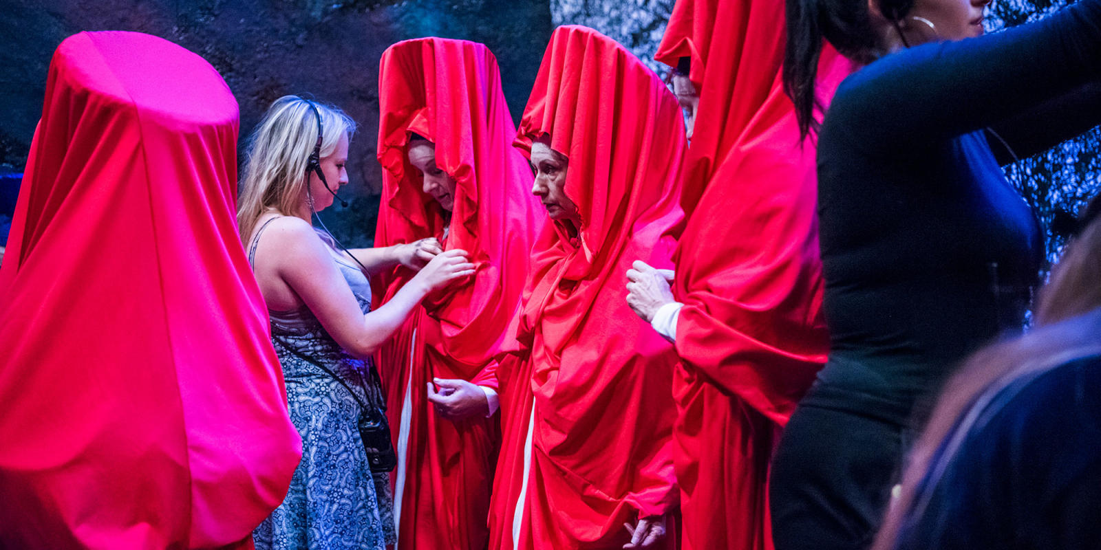 The female members of the chorus having their costumes adjusted by Emily Adamson (c) Tristam Kenton