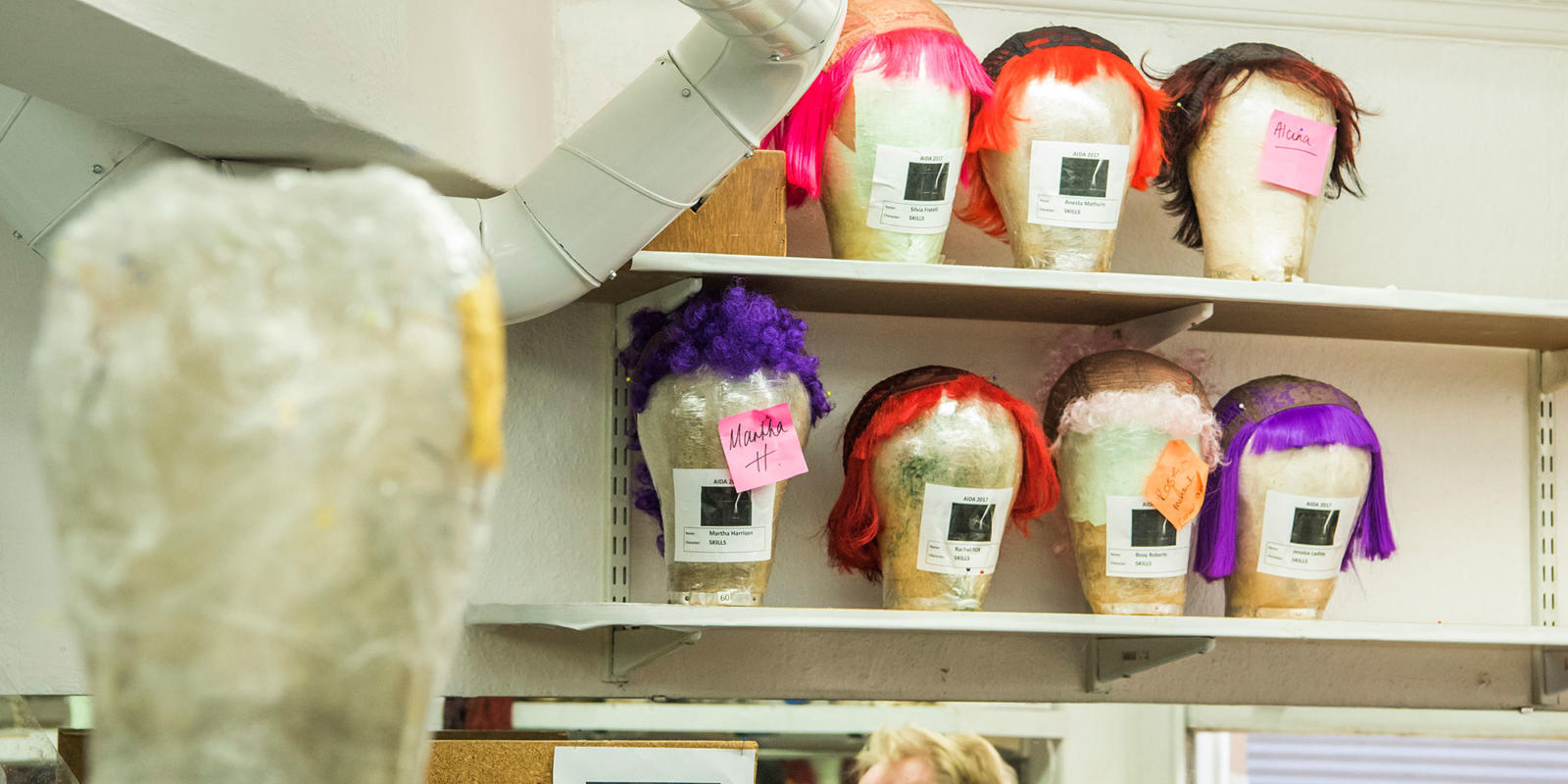 Wigs backstage ready to be worn by the acrobats (c) Tristram Kenton