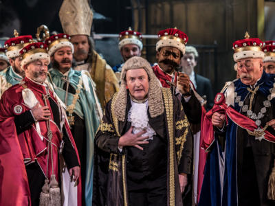 The Lord Chancellor in Iolanthe surrounded by chorus members