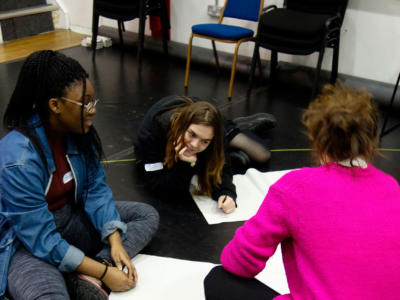 Sam and members of the ENO Youth Company creating ideas for their project