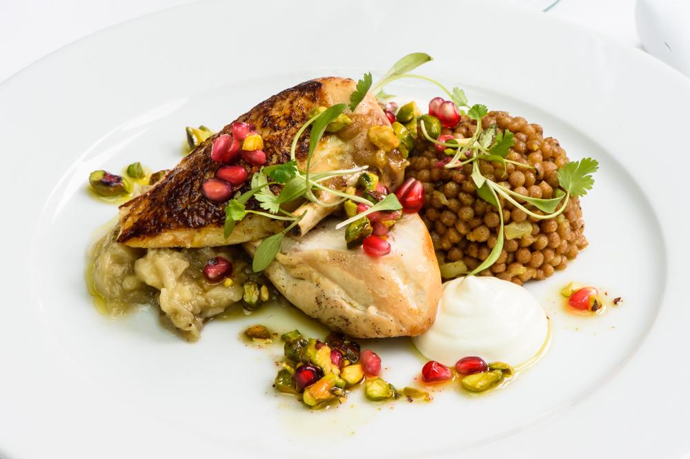 Roast Chicken breast, raz el hanout couscous, aubergine caviar, smoked yoghurt, pistachio and pomegranate dressing