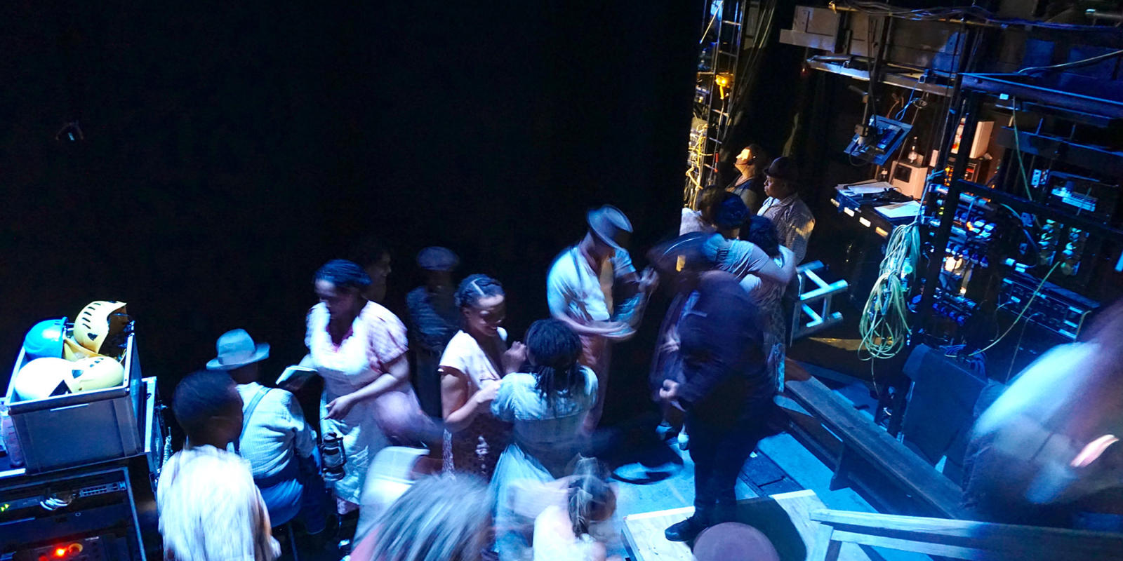 ENO Porgy and Bess: Members of the ensemble wait to go on stage for the thunderstorm scene