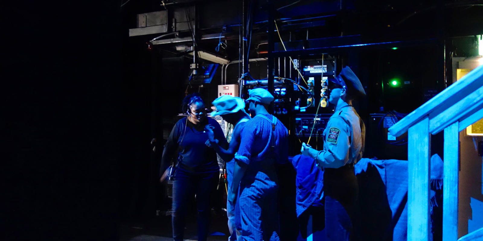 Deputy Stage Manager Lorrell Rawlins (left) talks with cast members