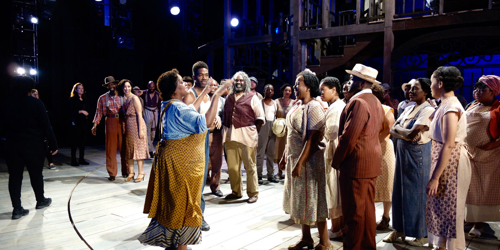 Tichina Vaughn directs cast and ensemble into getting ready for a whole group picture
