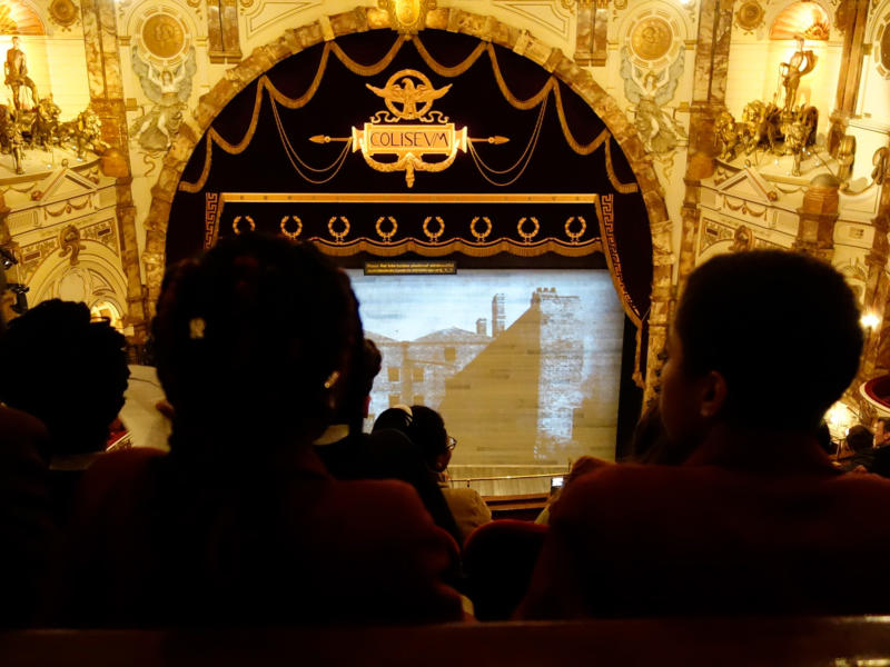 Young people in the balcony of the London Coliseum auditorium