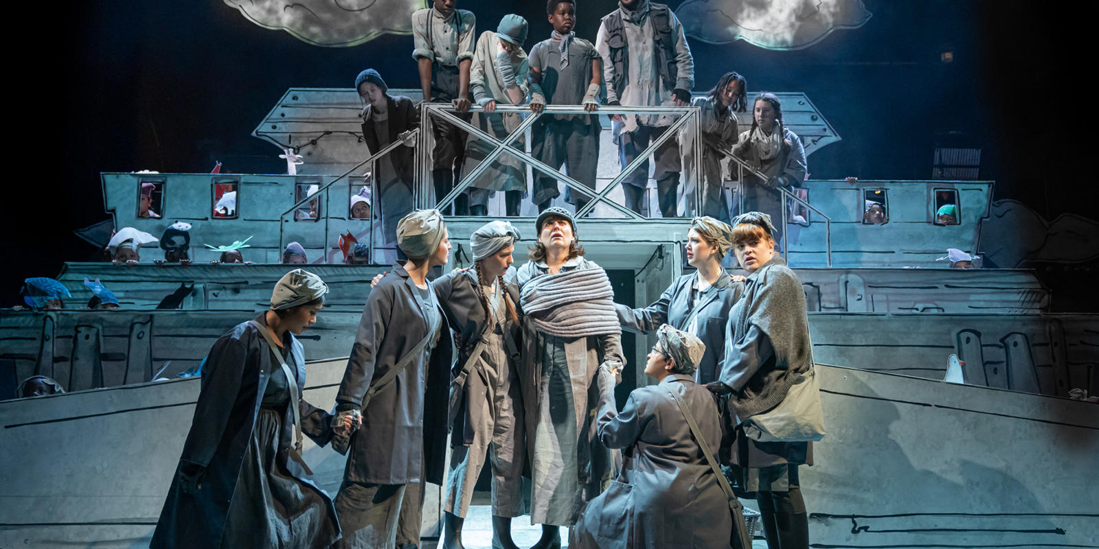 Louise Callinan (Mrs Noah) and Gossips in Noye's Fludde at Theatre Royal Stratford East